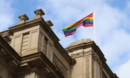 A rainbow flag is seen above Parliament House in Victoria as premier Daniel Andrews makes an apology for laws criminalising homosexuality.