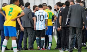 Argentina's Lionel Messi and Brazil's Neymar talk as the game is interrupted by health authorities.