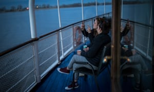 Younger tourists relax on board the Alexander Nevsky