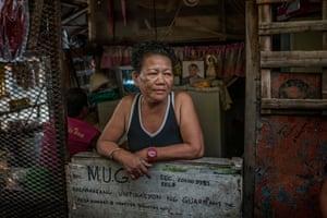 Rosita Opiasa, 59 in her home in Market 3 slum