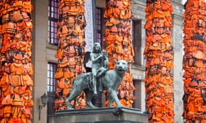 Ai weiwei's installation of life jackets, used by migrants, attached to the pillars of Berlin's Konzerthaus in 2016.