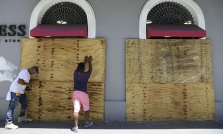 Workers cover shop windows with wood in preparation for protests against Governor Ricardo Rosselló near La Fortaleza in San Juan, Puerto Rico, on Wednesday.
