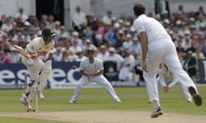 David Warner avoids a bouncer from England's Steve Finn