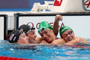 Tatjana Schoenmaker of Team South Africa is congratulated by Lilly King of Team United States, Annie Lazor of Team United States and Kaylene Corbett of Team South Africa after winning the gold medal and breaking the world record