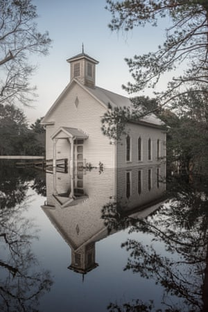 A church flooded by Hurricane Florence stands silently in its reflection in Burgaw, North Carolina.