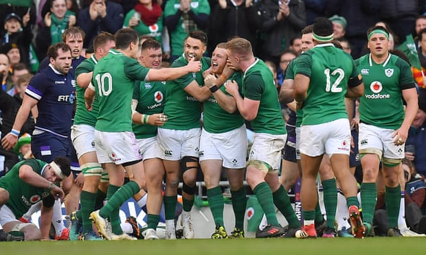Ireland players celebrate after their crucial fourth try in the win over Scotland.