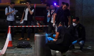 Police collect evidence at the scene of the attack in the Taikoo Shing district of Hong Kong.