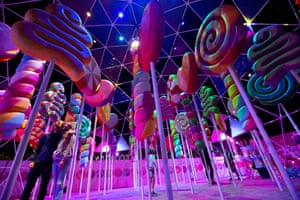 Visitors pose for photos at Sugar Rush, a candy-based theme park in Woodland Hills, California