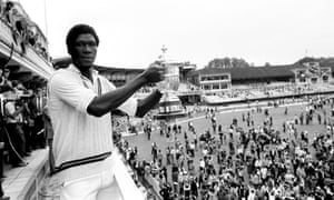 Joel Garner holds the trophy after West Indies beat England in the 1979 Cricket World Cup final at Lord's.