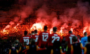 Young Boys fans set off flares as the players walk out before the Champions League match between Manchester United and Young Boys of Bern.