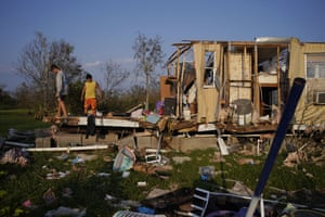 Aiden Locobon and Rogelio Paredes look through the remnants of their family's home destroyed by Hurricane Ida.