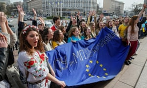 Ukrainian students form a chain from the Dutch embassy to European Square in Kiev a day before the referendum.