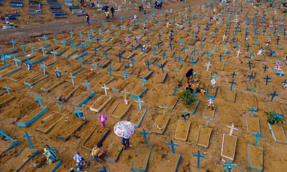 People visit the Nossa Senhora Aparecida cemetery in Manaus, Brazil.
