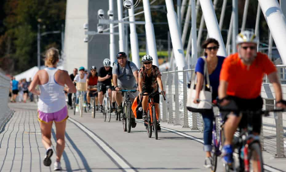 Runners and cyclists make their away across the Tilikum Crossing bridge in Portland, opened in September 2015.
