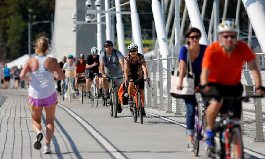 Cyclists on the Tilikum Crossing in Portland, Oregon