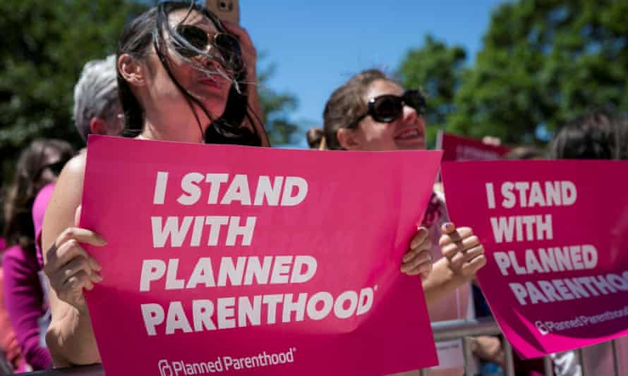 Demonstrators hold placards during a Planned Parenthood rally outside the state capitol in Austin, Texas, in 2017. But is this really the best slogan?