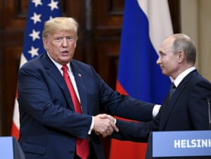 Trump shakes hands with Putin after his conversation at the summit in Helsinki in 2018.