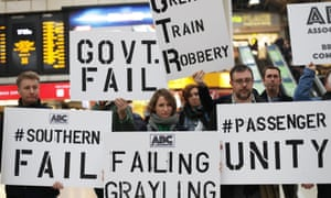 Commuters stage a protest at Victoria Station, London, amid the continued disruption on Southern Railway.