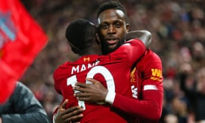 Divock Origi celebrates with Sadio Mane after opening the scoring at Anfield in the Merseyside derby.