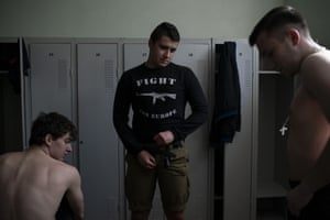 Nationalists get changed after a martial arts training session in Kiev