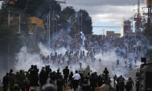 Soldiers and police launch teargas at demonstrators in Tegucigalpa, Honduras, in January.