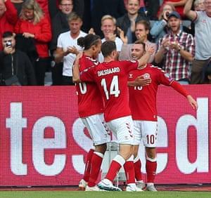 Eriksen celebrates scoring the opening goal.