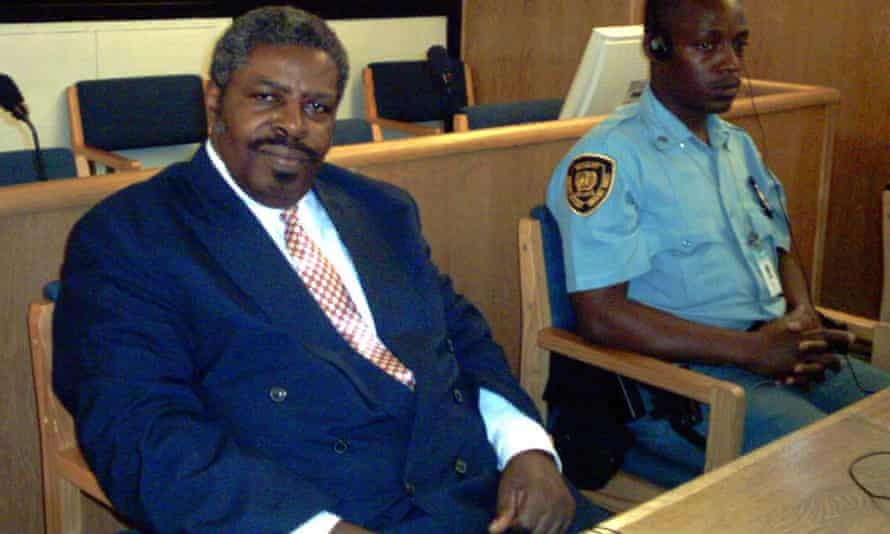 Eliezer Niyitegeka former minister of information in Rwanda sits next to the UN security officer at the 21 April 2004 International Court tribunal for Rwanda (ICTR) in Arusha.