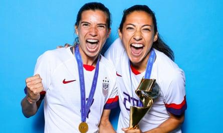 Tobin Heath and Christen Press after winning the 2019 Women's World Cup.