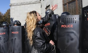 A woman confronts police during an opposition rally in Yerevan, Armenia