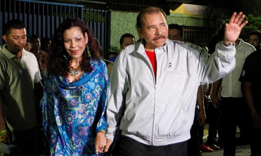 Daniel Ortega, Nicaragua's president, waves to the media beside his vice-presidential candidate and wife, Rosario Murillo after they casted their vote.