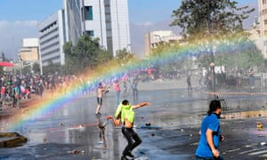 Demonstrators clash with riot police in Santiago on Thursday after a week of street violence,