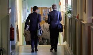 Boys walking down a school corridor