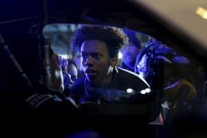 Protestors including Lamon Reccord, 16, confront police during a demonstration after video footage was released showing the shooting of black teenager Laquan McDonald by a police officer in Chicago, Illinois