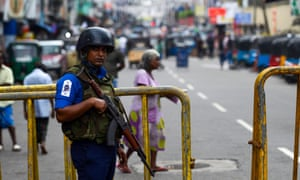 A Sri Lankan soldier stands guard outside St Anthony's shrine in Colombo, a week after a series of bomb blasts targeting churches and luxury hotels on Easter Sunday.