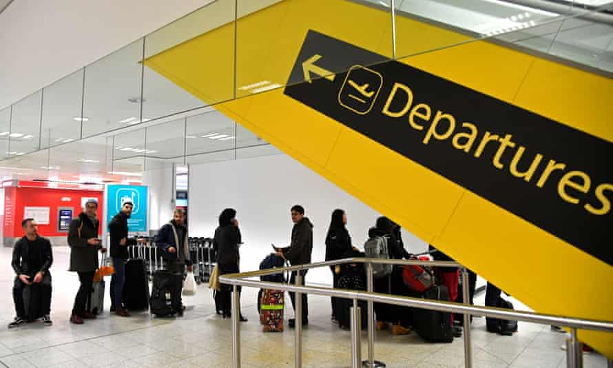 Passengers wait in the South Terminal building at Gatwick shortly after the airport reopened to flights following its forced closure because of drone activity.