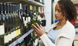 Hmmm… so many choices, of shops as well as wines for this young woman shopping in a supermarket.