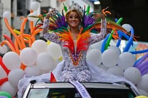 Panama City, Panama. The 2021 Pride empress waves to revellers