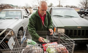 A man in North Carolina uses a food bank to supplement his $16 monthly food stamps.