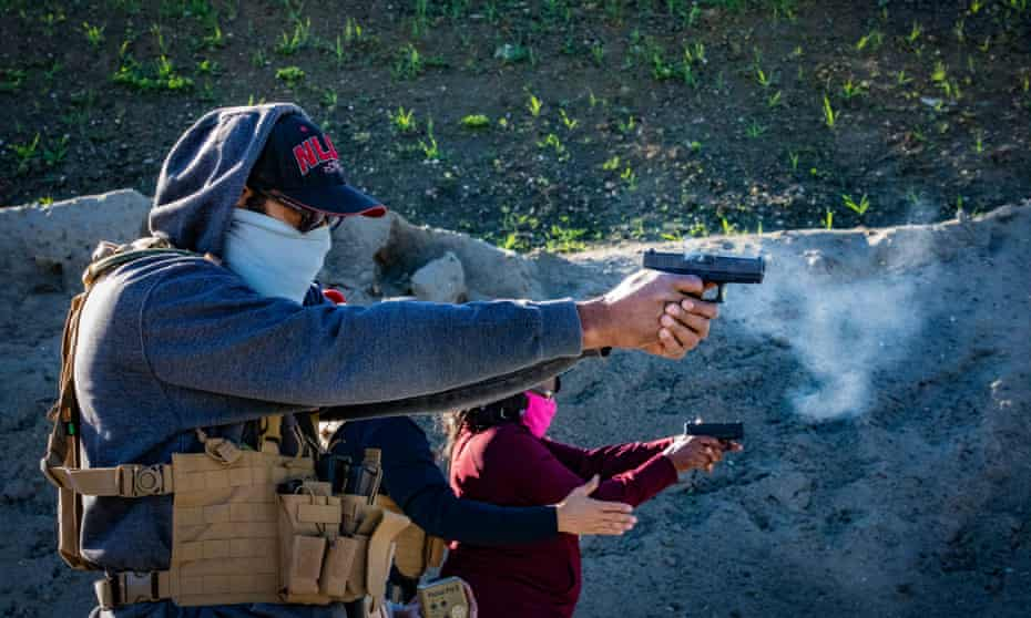 Two novice gun owners practice their marksmanship at a recent training for beginners organized by Black Gun Owners Association at the Richmond Rod & Gun Club.