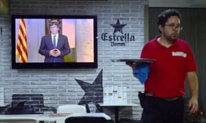 Catalan president Carles Puigdemont makes an address on television.