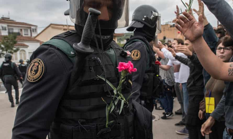 A police officer with a pink flower on his vest