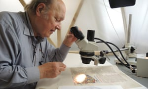 Christopher Clarkson fixing loose pigment on a miniature from the Winchester Bible.