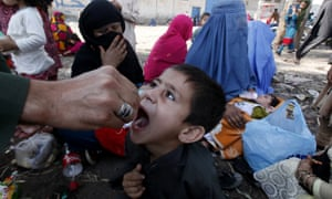 An Afghan refugee child is vaccinated for polio at a repatriation centre on the border with Pakistan
