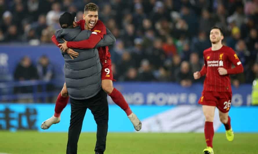 Roberto Firmino celebrates his second goal with Jürgen Klopp on the touchline.