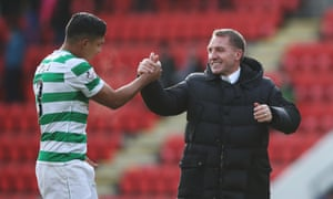 Celtic manager Brendan Rodgers celebrates with player Emilio Izaguirre