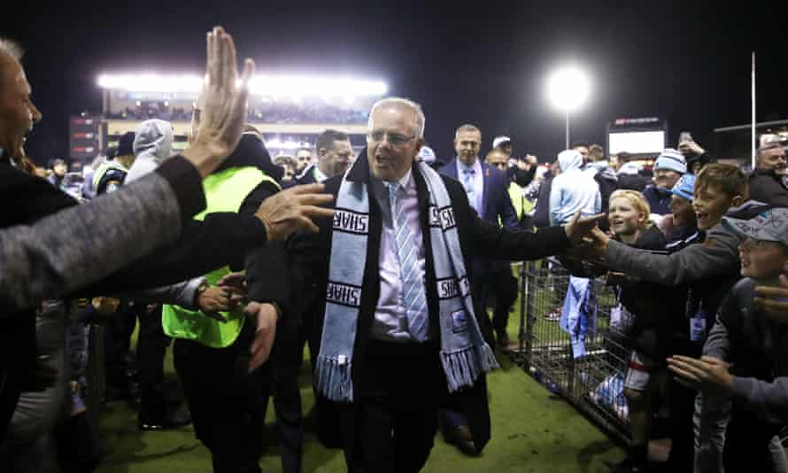 Scott Morrison in a Sharks scarf at the football