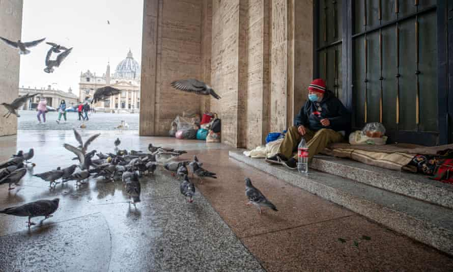 A homeless man living under the colonnade in front of St Peter's Square in Rome, Italy, where the economic gap between it and richer eurozone states has widened.