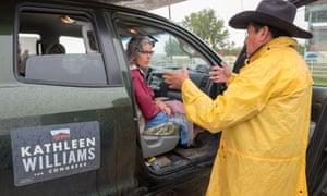 Kathleen Williams speaks with Crow tribal member Ken Real Bird.
