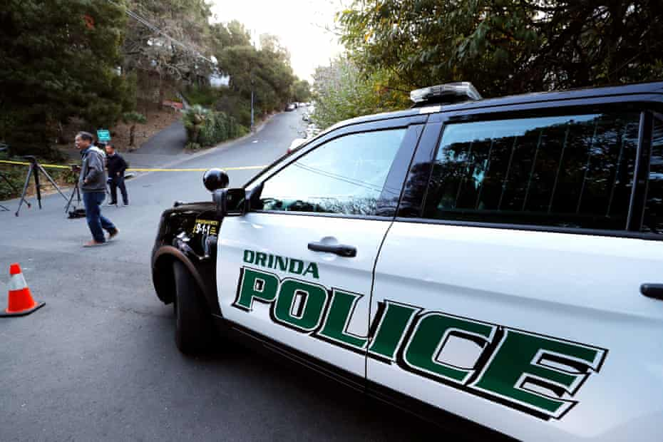 Orinda police line the street at the scene of a Halloween party shooting that killed five.