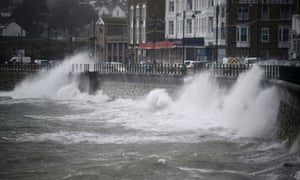 Waves crash against the harbour wall in Penzance, Cornwall.
